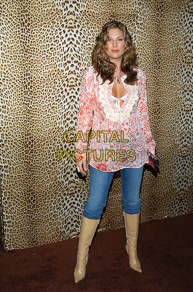 DAISY FUENTES.Roberto Cavalli unveils his Beverly Hills Boutique on Rodeo Drive with a private party to benefit Race to Erase MS at the Roberto Cavalli Boutique. Beverly Hills, California .February 15th, 2005.full length pink floral print top bra see through flowing brown boots tucked into jeans.www.capitalpictures.com.sales@capitalpictures.com.© Capital Pictures.
