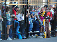 Feb 29, 2008; Las Vegas, NV, USA; NASCAR Sprint Cup Series driver Kyle Busch signs autographs during qualifying for the UAW Dodge 400 at Las Vegas Motor Speedway. Mandatory Credit: Mark J. Rebilas-US PRESSWIRE