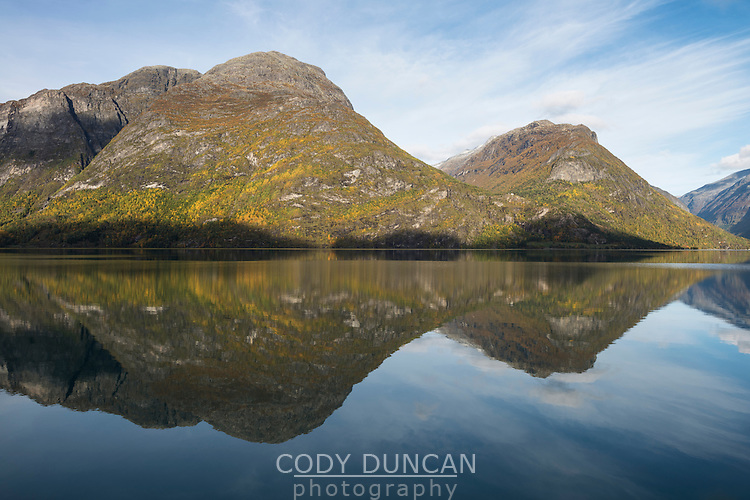 Autumn mountain reflection on lake Oppstrynsvatnet, Sogn of Fjordane, Norway