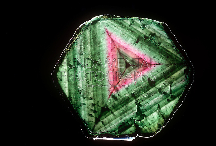 CRYSTAL AND CUT ZONED TOURMALINE<br /> Cross Section of Zoned Tourmaline Crystal<br /> Mineral Liddicoatite crystal cross section shows triangular banding.
