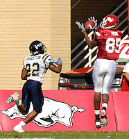 Florida International University Golden Panthers versus the University of Arkansas Razorbacks at Donald W. Reynolds Razorback Stadium, Fayetteville, Arkansas on Saturday, October 27, 2007.  The Razorbacks defeated the Golden Panthers, 58-10...Arkansas wide receiver Marcus Monk (85) beats FIU defensive back Lionell Singleton (22) to the corner of the end zone and hauls in a Nathan Emert touchdown pass in the second quarter. .