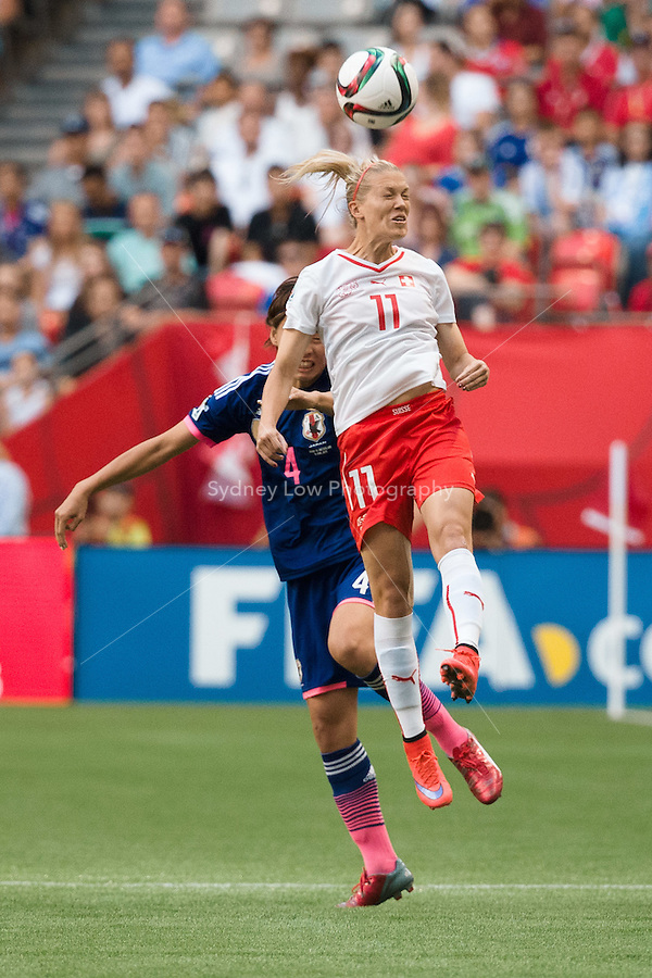 June 8, 2015: Lara DICKENMANN of Switzerland heads the ball during a Group C match at the FIFA Women's World Cup Canada 2015 between Japan and Switzerland at BC Place Stadium on 8 June 2015 in Vancouver, Canada. Sydney Low/AsteriskImages