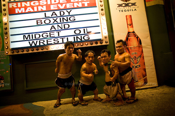 In the red light area of Manila's Makati district, customers who've had enough of dancing girls have another form of exploitation to amuse them: midget oil wrestling.