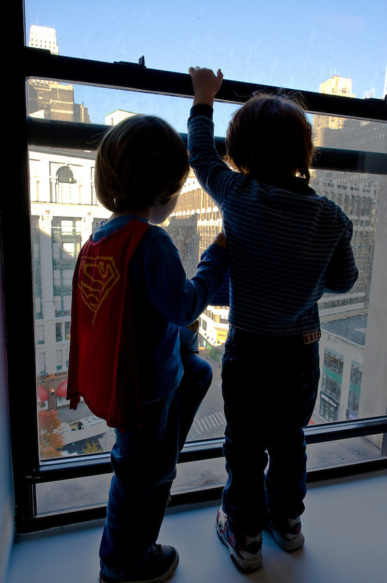 Luke and Donovan watching parade in window.
