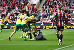 Chris Basham of Sheffield Utd in action with Angus Gunn of Norwich City during the Championship match at Bramall Lane Stadium, Sheffield. Picture date 16th September 2017. Picture credit should read: Jamie Tyerman/Sportimage