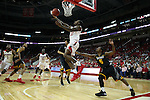 27 November 2015: NC State's Anthony (Cat) Barber (12) scores on a reverse layup. The North Carolina State University of North Carolina Wolfpack hosted the Winthrop University Eagles at the PNC Arena in Raleigh, North Carolina in a 2015-16 NCAA Division I Men's Basketball game. NC State won the game 87-79.