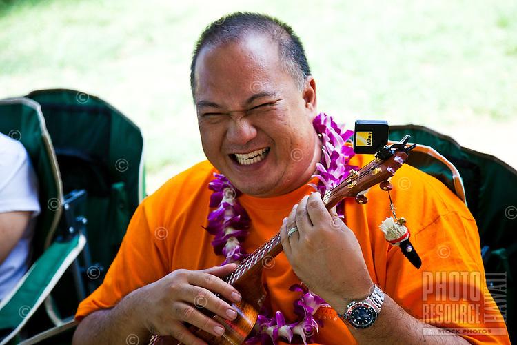 Festival oranizer Jayson Tanega plays his ukulele at the 40th Annual Ukulele Festival at Kapiolani Park