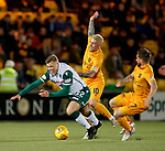 29.03.2019 Livingston v Hibs: Florian Kamberi fouled by Craig Sibbald and Keaghan Jacobs