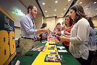 NWA Democrat-Gazette/BEN GOFF @NWABENGOFF<br /> Trent Guleserian, admissions councilor from Oklahoma Baptist University, talks with Rogers High senior Alice Pedraza (right) and her older sister Diana Pedraza on Monday Sept. 14, 2015 during the annual Benton County College Fair hosted by Northwest Arkansas Community College in Bentonville. Representatives from colleges in Arkansas and surrounding states, as well as the armed services, attended the event for Benton County high school students considering their higher education options.