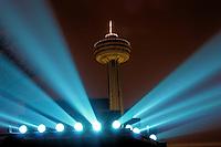 Night view of the Skylon tower at Niagara Falls beween the spotlights for the falls