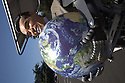 A robot with a grinning Arnold Schwarzenegger mask holds a globe of planet earth in his hands. The image could be used to symbolize Schwarzenegger's political involvement in environmental legislation in California. Can help save planet earth? Contact Green Stock Media to view additional images from this photo shoot. ..Image size: 4368 x 2912 pixels, very high resolution, 12.8 megapixels