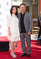 LOS ANGELES, USA. April 12, 2019: Billy Crystal & Janice Crystal at the hand & footprint ceremony honoring Billy Crystal at the TCL Chinese Theatre.<br /> Picture: Paul Smith/Featureflash