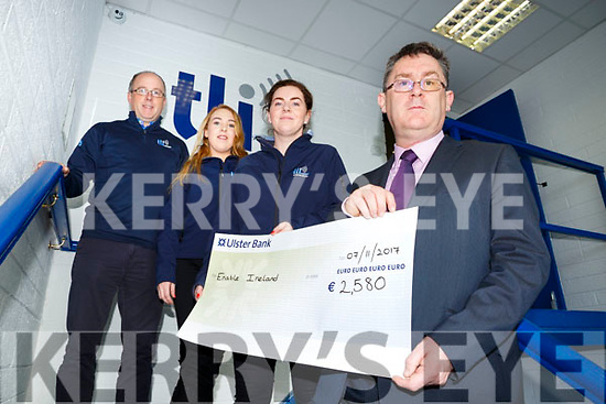 Donagh Shanahan, Aideen O Connor and Brendan O'Sullivan  of TLI Abbeydorney presented  a cheque for €2,580 to Sean Scally of  Enable Ireland proceeds of a of a walk held in Oct and a fancy dress event