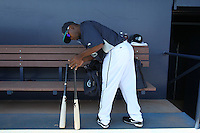 PEORIA - MARCH 5:  Chone Figgins of the Seattle Mariners gets his bats ready in the dugout before a spring training game against the San Diego Padres on March 5, 2010 at the Peoria Sports Complex in Peoria, Arizona. (Photo by Brad Mangin)