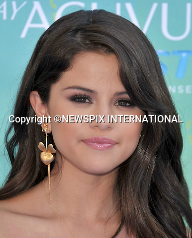 """SELENA GOMEZ.attends the Teen Choice 2011 at the Gibson Amphitheatre, Universal City, California_07/08/2011.Mandatory Photo Credit: ©Crosby/Newspix International. .**ALL FEES PAYABLE TO: """"NEWSPIX INTERNATIONAL""""**..PHOTO CREDIT MANDATORY!!: NEWSPIX INTERNATIONAL(Failure to credit will incur a surcharge of 100% of reproduction fees).IMMEDIATE CONFIRMATION OF USAGE REQUIRED:.Newspix International, 31 Chinnery Hill, Bishop's Stortford, ENGLAND CM23 3PS.Tel:+441279 324672  ; Fax: +441279656877.Mobile:  0777568 1153.e-mail: info@newspixinternational.co.uk"""
