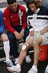 26 May 2006: Frankie Hejduk (r), who suffered a knee injury and has been replaced on the U.S. World Cup squad, shows off his scars to U.S. team captain Claudio Reyna (l). The United States Men's National Team defeated their counterparts from Venezuela 2-0 at Cleveland Browns Stadium in Cleveland, Ohio in a men's international friendly soccer game.