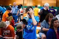 NWA Democrat-Gazette/CHARLIE KAIJO Carson Martin, 10, of Sugarland, TX. watches fellow competitors shoot through a telescope during the 2018 annual Daisy National BB Gun Championship, Monday, July 2, 2018 at the John Q. Hammons Center in Rogers. <br />