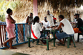 BELIZE, Hopkins, men play dominoes near the beach in Hopkins