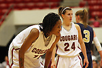 Jazmine Perkins (#11), Washington State freshman, catches her wind during a stoppage in play during the Cougars game against Montana State in Pullman, Washington, on November 23, 2008.  The Cougars prevailed in the contest, 78-66.
