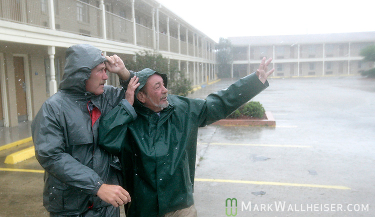 Mike Maddocks (L) and Alvin Champagne, managers for the Days Inn in Morgan City, Louisiana  check their 140 room hotel for damage as Hurricane Gustav make landfall September 1, 2008.    (Mark Wallheiser/TallahasseeStock.com)