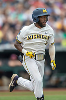 Michigan Wolverines outfielder Christian Bullock (5) runs to first base during Game 1 of the NCAA College World Series against the Texas Tech Red Raiders on June 15, 2019 at TD Ameritrade Park in Omaha, Nebraska. Michigan defeated Texas Tech 5-3. (Andrew Woolley/Four Seam Images)