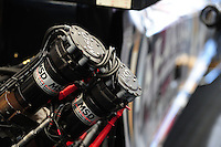 May 5, 2012; Commerce, GA, USA: Detailed view of ignition magnetos on a NHRA top fuel dragster in the pits during qualifying for the Southern Nationals at Atlanta Dragway. Mandatory Credit: Mark J. Rebilas-