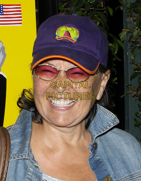 "ROSEANNE BARR.""Capitalism: A Love Story"" Los Angeles Premiere held At AMPAS Samuel Goldwyn Theater, Beverly Hills, California, USA..September 15th, 2009.headshot portrait jean denim smiling teeth tinted glasses baseball cap hat blue.CAP/ADM/KB.©Kevan Brooks/AdMedia/Capital Pictures."