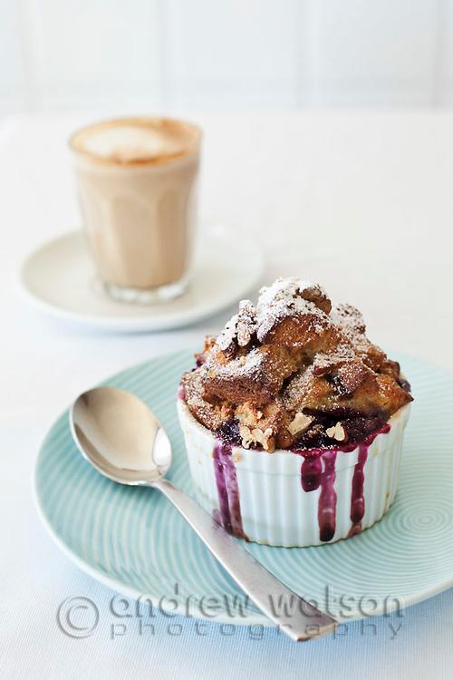 Blueberry cobbler in ramekin with coffee.