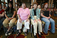 """Southern Arizona Women's Chorus members Joan Kroeckel (JOAN KROECKEL), second from left, and Sally Micek (SALLY MICEK) close their eyes while warming up their voices among members of the Pope John Paul II High School Advanced Women's Chorus and the St. Cecilia Academy Chorus during a rehearsal at the Grand Hyatt in New York, NY on Friday, June 23, 2006.  The group performed Brusa's """"Missa pro defunctis"""" and Beach's """"The Rose of Avontown, Op. 30"""" at Carnegie Hall on Sunday night."""