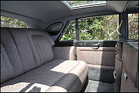 BNPS.co.uk (01202 558833)<br /> Pic: Bonhams/BNPS<br /> <br /> Hand woven silk upholstery.<br /> <br /> Downfall - The car that led to the chairman of Daimler's dramatic fall after the extravagent behaviour of his notorious socialite wife.<br /> <br /> This luxurious limousine designed by legendary aristocrat Lady Docker as a vanity project, and which eventually cost her and her husband their jobs, is tipped to sell for &pound;160,000 at Bonhams.<br /> <br /> The unique 'Stardust' Daimler was one of five show cars styled by exuberant socialite Lady Docker and cost so much they almost bankrupt the company behind them.<br /> <br /> The 1954 dark blue Daimler was so lavish it has 5,000 hand painted silver stars on the exterior, an interior full of crocodile skin and hand woven silk, and even a dancer mascot on the bonnet modelled on ex-showgirl Norah Docker herself.<br /> <br /> The flamboyant vehicle is even being sold with an invitation to Princess Grace's Monaco wedding in 1956, to which the Dockers shipped two of the luxury cars for their own personal use, and was the final straw for frustrated Daimler board members back home in austerity hit Britain.