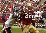 Chicago Bears linebacker Warrick Holdman (53) catches up with San Francisco 49ers running back Kevan Barlow (32) on Sunday, September 7, 2003, in San Francisco, California. The 49ers defeated the Bears 47-7.