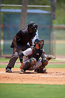 GCL Marlins catcher Will Banfield (10) awaits a pitch in front of home plate umpire Tre Jester during a game against the GCL Mets on August 3, 2018 at St. Lucie Sports Complex in Port St. Lucie, Florida.  GCL Mets defeated GCL Marlins 3-2.  (Mike Janes/Four Seam Images)