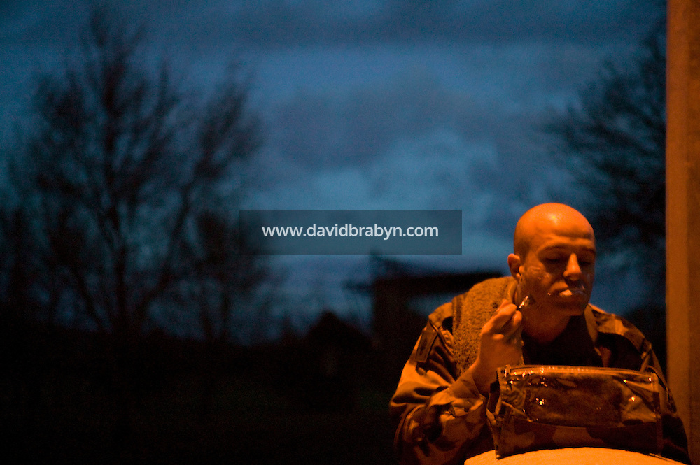 Caporal-Chef Olivier Stull of the French Foreign Legion shaves in the early morning hours of 11 December 2007 after a night spent outdoors during a full scale exercise in Tarbes, France.