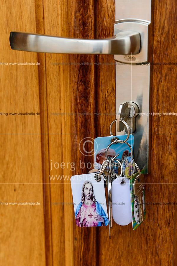 MADAGASCAR, Antananarivo, new SVD church in AMBATOBE, keys at door / MADAGASKAR, Antananarivo, neue SVD Kirche in AMBATOBE, Schluesselbund mit Anhaenger von Jesus und Pabst Johannes Paul II an der Tuer
