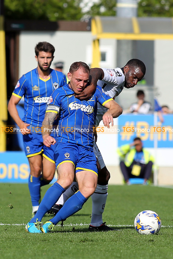 Barry Fuller of AFC WImbledon and Notts County's Izale McLeod challenge for the ball during AFC Wimbledon vs Notts County, Sky Bet League 2 Football at the Cherry Red Records Stadium, Kingston, England on 19/09/2015
