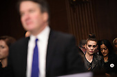 Actress Alyssa Milano (R) listens to Supreme Court nominee Brett Kavanaugh as he testifies before the US Senate Judiciary Committee on Capitol Hill in Washington, DC, September 27, 2018. <br /> Kavanaugh was to testify in front of the panel next on Thursday afternoon, having stridently rejected the allegations of sexual abuse by Blasey Ford and two other women in prepared remarks. / POOL / SAUL LOEB