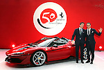 "December 13, 2016, Tokyo, Japan - Italian sports car maker Ferrari senior vice president and chief designer Fravio Manzoni (R) and senior vice president and chief marketing officer Enrico Galliera display the new vehicle ""Ferrari J50"" at the world premier in Tokyo on Tuesday, December 13, 2016 to celebrate Ferrari's 50th anniversary in Japan. Ferrari J50 has 3.9-litter V8 turbo charged engine to drive roadster body.  (Photo by Yoshio Tsunoda/AFLO) LWX -ytd-"