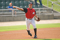 Third baseman Jon Gilmore #20 of the Kannapolis Intimidators makes a throw to first base against the Bowling Green Hot Rods at Fieldcrest Cannon Stadium August 23, 2009 in Kannapolis, North Carolina. (Photo by Brian Westerholt / Four Seam Images)