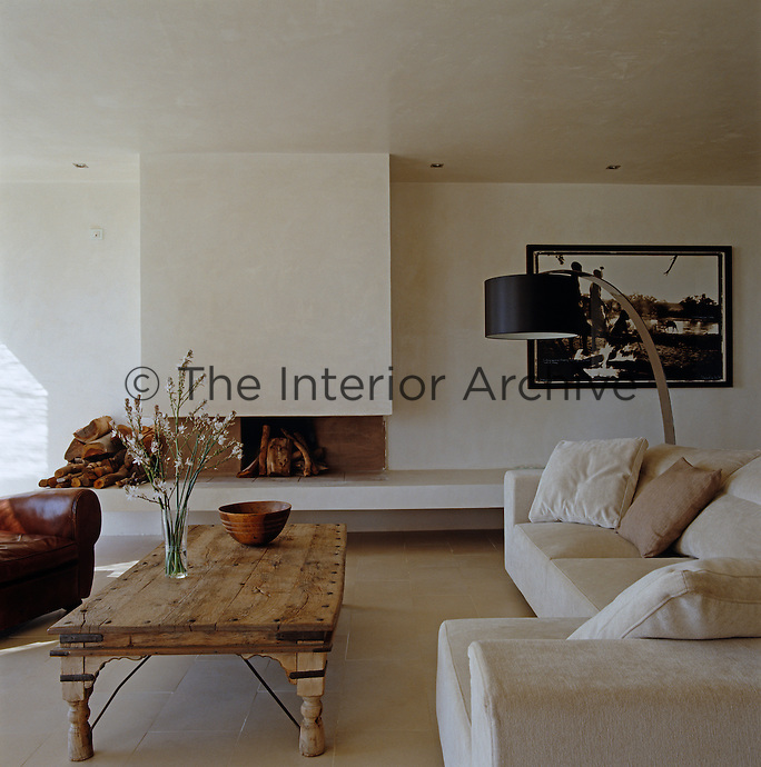The living room is comfortably furnished and has an open fireplace for the winter. The photograph beside the fireplace is by Alexis de Villar