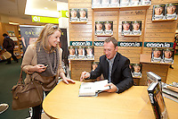 NO REPRO FEE.8/10/2011. Eason, Ireland's leading retailer of books, stationery, magazines and lots more, hosted a book signing by Jockey, Paul Carberry.  Pictured at Eason, O'Connell Street, Dublin are Aoife Mc Donald and Paul Carberry who signed copies of his new autobiography One Hell of a Ride. Follow Eason on Twitter - @easons For further information, please contact: Aoife McDonald WHPR 087 4100777 . Picture James Horan/Collins Photos