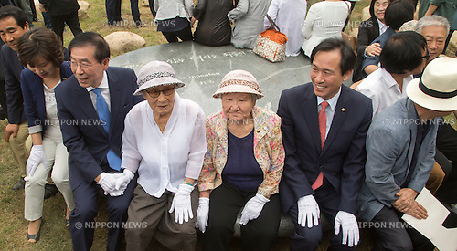 Kim Bok-dong, Kil Won-ok and Park Won-soon, Aug 29, 2016 : Kim Bok-dong (4th L) and Kil Won-ok (C), who said that they were forced to become a sex slave by Japanese army during World War II, Seoul Mayor Park Won-soon (3rd L) and the floor leader of the main opposition Minjoo Party of Korea, Woo Sang-ho (6th L) attend an opening ceremony for a park commemorating the victims of Japan's sexual enslavement during Japan's occupation of the Korean Peninsula (1910-45), on Mount Nam in Seoul, South Korea. The Seoul Metropolitan Government and a committee which is charge of building the memorial park held the ceremony on Monday, which  marks the 106th anniversary of the colonization. The place of the memorial park is the former residence of Japan's colonial-era resident-general, where the annexation treaty between Korea and Japan was signed on August 22, 1910. The treaty went into effect one week later. (Photo by Lee Jae-Won/AFLO) (SOUTH KOREA)