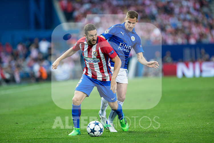 Koke Resurrecccion of Atletico de Madrid competes for the ball with Marc Albringhton of Leicester City Football Club  during the match of  Champions LEague between  Atletico de Madrid and LEicester City Football Club at Vicente Calderon  Stadium  in Madrid, Spain. April 12, 2017. (ALTERPHOTOS / Rodrigo Jimenez)