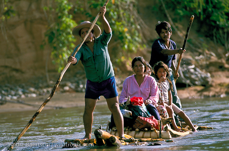 Quechua Indian family from San José de Uchupiamonas travelling on a balsa raft to Rurrenabaque, lowland tropical rainforest along the Rio Tuichi, Madidi National Park, La Paz, Bolivia.