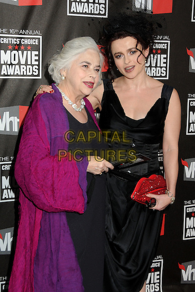 ELENA PROPPER DE CALLEJON & HELENA BONHAM CARTER .at The16th Annual Critics' Choice Movie Awards held at The Hollywood Palladium in Hollywood, California, USA, January 14th, 2011..half  length black dress red clutch bag sleeveless corset hat netting mouth lips lulu guinness vivienne westwood mother mum mom daughter family purple coat jacket .CAP/ADM/BP.©Byron Purvis/AdMedia/Capital Pictures.