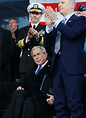New York, NY - November 11, 2008 -- United States President George W. Bush sits while others give him a standing ovation on Veteran's Day at the rededication ceremony of the Intrepid Sea, Air and Space Museum in New York City on Tuesday, November 11, 2008.<br /> Credit: John Angelillo - Pool via CNP