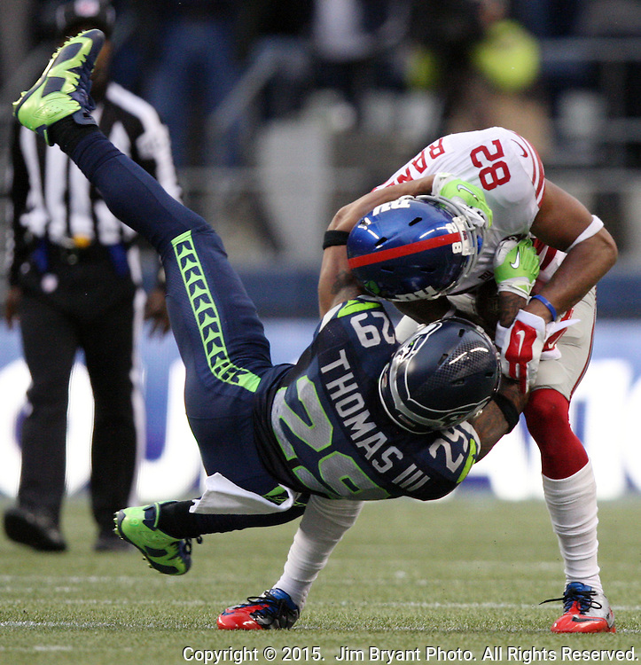 Seattle Seahawks  free safety Earl Thomas (29) tackles New York Giants wide receiver Rueben Randle (82) at CenturyLink Field in Seattle, Washington on November 9, 2014. The Seahawks  beat the Giants 38-17.   ©2014. Jim Bryant Photo. All rights Reserved.