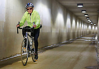 NWA Democrat-Gazette/DAVID GOTTSCHALK  Oscar Johnson, of Bella Vista, travels in the tunnel below the Fulbright Expressway  on the Razorback Regional Greenway Trail in Fayetteville Thursday, August 20, 2015. Johnson was including the 37 mile long trail as part of a round trip that will end up as a more than 100 mile ride beginning north of the Arkansas state line in Missouri and traveling to the southern paved point of the trail in Fayetteville.
