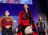 US President Barack Obama receives a traditional blanket and hat during the 2016 White House Tribal Nations Conference at the Andrew W. Mellon Auditorium, September 26, 2016, Washington, DC.  <br /> The conference provides tribal leaders with opportunity to interact directly with federal government officials and members of the White House Council on Native American Affairs. <br /> Credit: Aude Guerrucci / Pool via CNP
