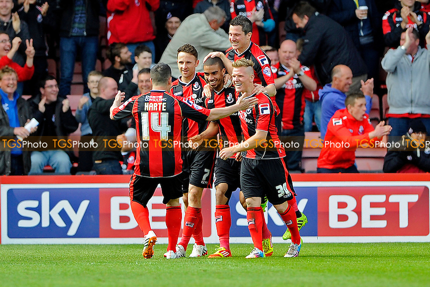 Lewis Grabban of AFC Bournemouth gets mobbed after scoring the second goal for AFC Bournemouth - AFC Bournemouth vs Nottingham Forest - Sky Bet Championship Football at the Goldsands Stadium, Bournemouth, Dorset - 26/04/14 - MANDATORY CREDIT: Denis Murphy/TGSPHOTO - Self billing applies where appropriate - 0845 094 6026 - contact@tgsphoto.co.uk - NO UNPAID USE