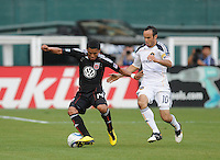 DC United midfielder Andy Najar (14) shields the ball against LA Galaxy midfielder Landon Donovan (10) . LA Galaxy defeated DC United 2-1 at RFK Stadium, Saturday July 18, 2010.